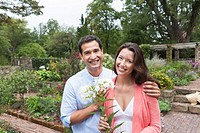 Portrait of happy couple in garden
