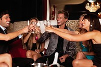 Friends toasting each other in club