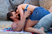 Couple hugging on beach towel