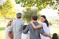 Multi_generation family walking in park