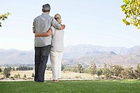 Senior couple looking at countryside view