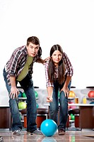 Young man and the girl in bowling