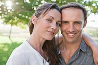 Close up portrait of smiling couple in park