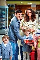 Happy family with children in shop