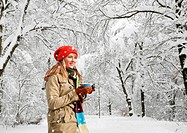 Woman drinking coffee in snow