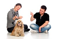 Girl, guy and american cocker spaniel