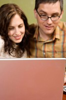 Woman and Man Staring at Laptop