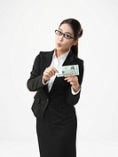 Portrait of businesswoman holding South Korean money bill