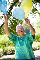Elderly lady with balloons