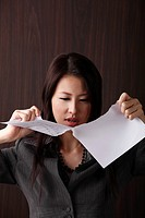 woman ripping paper