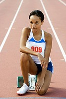 Female runner crouched at starting line