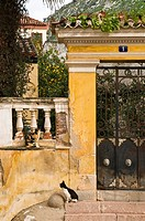 Faded elegance of a neo classic entrance to a garden in the old town of Nafplio, Greece's first capital after independence, argolid, Peloponnese, Gree...