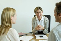 Businesswoman talking with clients in office