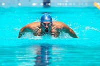 Young Man Swimming Butterfly
