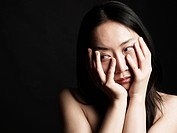 Young Asian Woman On Black Background.