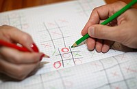 Man and woman playing Tic_tac_toe game