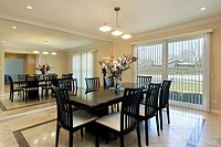 Dining room with black chairs and table