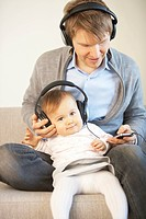Father and Baby Girl Listening To Headphones