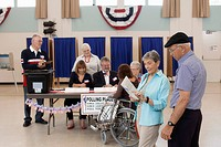 Workers working at registration table in polling place