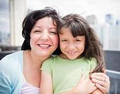 Hispanic mother and daughter hugging