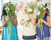 Girls holding bouquets of flowers