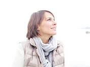 Germany, Munich, Mature woman in warm clothing, smiling