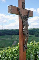 France, Champagne, Champillon, crucifix next to vineyard