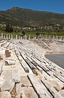 The stadium at Ancient Messene Ithomi with the modern village of Mavromati in the background, Messinia, Southern Peloponnese, Greece