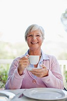 Older woman having cup of coffee