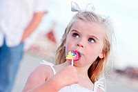 Adorable Little Girl Enjoying Her Lollipop Outside