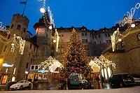 Europe, Switzerland, Saint Moritz, Hotel Palace at dusk with Christmas lights ...