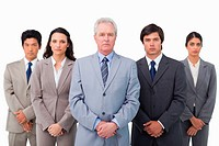Mature businessman standing together with his team against a white background