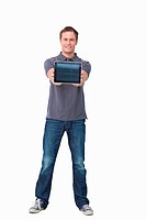 Smiling young man showing screen of tablet computer against a white background