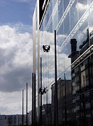 Ireland, Dublin, window washer in modern skyscrape                                                                                                    ...