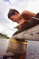 Boy fishing from pier