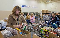 Fraser, Michigan - Wendy Harkey, a volunteer from Chrysler Corp , boxes food for clients at the Hope Center, a food pantry serving unemployed and low ...