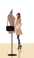 Woman looking at mannequin with purse