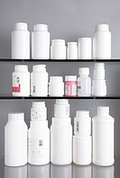 Close_up of pill bottles kept on shelves