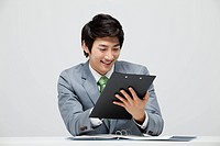 Asian Businessman Looking At Office Document
