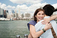 Couple hugging in front of skyline, New York City, USA