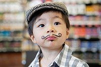 Boy 3-4 with painted moustache, portrait (thumbnail)