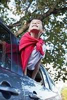 Boy 5_6 in costume leaning out car window