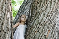 Girl 3_4 among big trees
