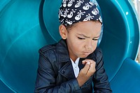 Portrait of boy 5-6 wearing headscarf and leather jacket (thumbnail)