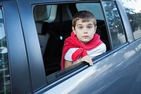 Close up of boy 5_6 sitting inside of car