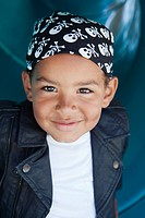 Portrait of boy 5_6 wearing headscarf and leather jacket