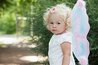 Portrait of cute girl 3-4 in butterfly costume (thumbnail)