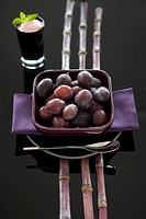 Prunes with bamboo and red wine creme