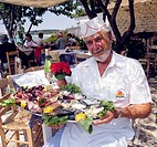 Greek Chef with fabulous plate of Fresh Fish, at Sani Beach in Halkidiki Greece