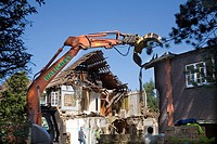 Demolishing a large house in west London to clear the site before constructing a new very high value property